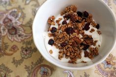 Looking to add some crunch to your breakfast routine? Homemade Maple Nut Granola is the perfect topping for yogurt and makes a beautiful breakfast by itself in a bowl with your favorite milk. Rolled oats, walnuts, pecans and dried cranberries are tossed in a mixture of cinnamon and maple syrup, then baked until crispy. This vegan, naturally sweetened granola is worlds away more delicious than any store-bought granola on the market!