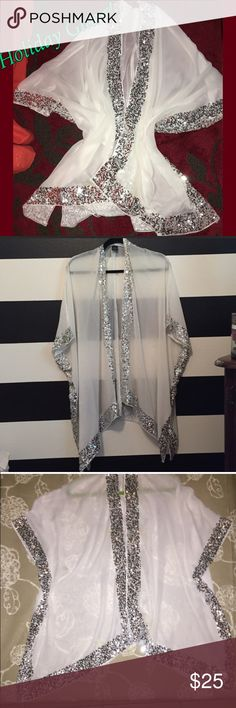 Silver Sequin Sheer Kimono Shrug 1X Such a stunner! This is a sheer white Kimono with silver sequins. Perfect to add over any outfit and jazz it up. Size says One Size Fits Most, but this is definitely larger and fits sizes 1-3X. Worn 1 time. EUC. Boutique Jackets & Coats