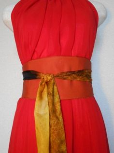 Cinch your waist with reversible obi belts that will flatter any body style.