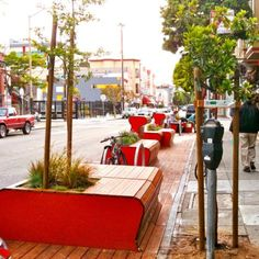 One idea that has spread around the globe is PARK(ing) Day, an annual event in September in which curb parking spaces are transformed into people places for a day. It all started in San Francisco in 2005, when a design firm called Rebar turned a single on-street parking space into a temporary public park with sod, a bench, and a tree. In 2011, the event grew to nearly 1,000 PARK(ing) Day parks in 162 cities worldwide. Parklet-Mission-District-San-Francisco