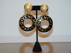 Givenchy, 70s, Glamazon logo earrings with pearl pendant stud. Gold and black, makes a sharp outfit look sharper. A Givenchy classic, just like the classic pump.