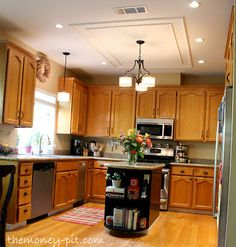 Step by Step Tutorial on how to paint your kitchen cabinets without having to give up the use of your kitchen.  Includes timeline and detailed explanations.