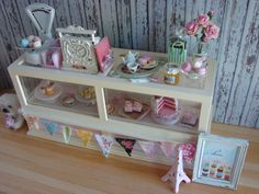 Sweet as can be, this vintage bakery display is full of sweet treats and more. Cookies, macarons, cake, sweet tea, even pre-packaged