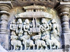 panel shows Krishna's mother, Yasoda and her ladies rocking the baby Krishna in a cradle. A group of cows stand at the forefront of the scene watching this divine scene. Ruvari Mallitamma, the famous Hoysala sculptor and architect, started his career in Amritheshwara Temple.