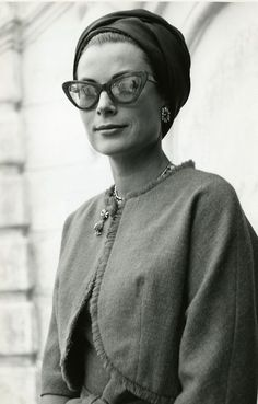 Glamorous: Six years after the wedding, Kelly (pictured at the Princely Palace of Monaco in 1962) looks every inch the star in a head scarf and fashionable spectacles
