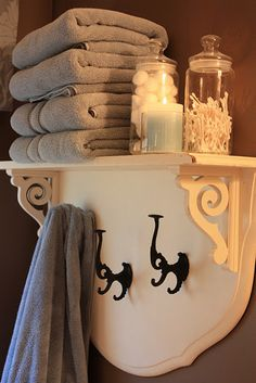 Headboard Shelf - Remove the bed posts, saw off the bottom of the headboard and screw the pieces together at an 90 degree angle. Then, add the brackets and vintage iron hooks.