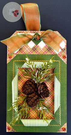 Susan Tierney-Cockburn's 3rd tag of Christmas with Els van de Burgt Studio - Tags & More 8 Lattice (961)! She creates these lifelike pinecones with her Garden Notes - Whitepine boughs & Pinecone (1091). As a final touch, she added Elizabeth Craft Designs - Peel Off Stickers (1016). Buy the supplies here: http://www.elizabethcraftdesigns.com/collections/susans-garden
