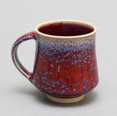 Wheel-thrown Porcelain Mug with red and blue speckles by Hsinchuen Lin. $40.00, via Etsy.
