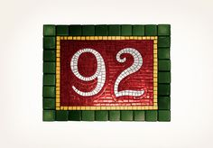 Designed by Louise Fili Ltd. The mosaics from the New York City subway system inspired 92, a classic brasserie. Although there is no 92nd Street stop, the logo has convinced many that it actually does exist.