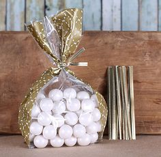 Gold cellophane bags with gold twist ties for packaging candy, baked goods, small treats and more!