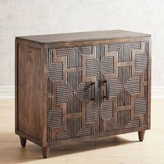 With a distinctly mid-century modern attitude, the Betaan two-door cabinet has an artfully carved front, tapered legs and a distressed finish. Crafted in India of mango and other hardwoods, it's just right for storing linens, craft supplies, bath products or other things you have that need a home. By Dileep for Pier 1 Imports. Mirror Cabinets, Wooden Cabinets, Storage Cabinets, Living Room Cabinets, Living Room Furniture, Living Room Decor, Cabinet Furniture, Accent Furniture, Furniture Ideas