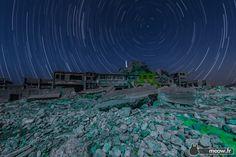 Exploration of Gunkanjima by night.