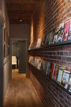 absolutely love this idea. Picture shelves for books- or anything you want, in the hallway. Can mix it up and change on a whim! For all my photo books! Flur Design, Hallway Designs, Hallway Ideas, Corridor Ideas, Entryway Ideas, Picture Shelves, Picture Rail, Picture Frames, Book Storage