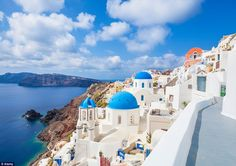 The small town of Oia is famous for buildings that are painted white and churches with th...