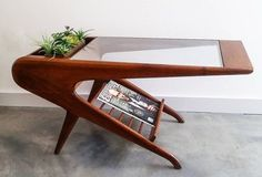 Hey, I found this really awesome Etsy listing at https://www.etsy.com/listing/249554719/sculptural-mid-century-coffee-table-in