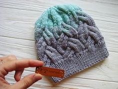 Add a pop of color to your winter gear with this fun cable knit hat pattern.