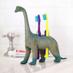 Drill holes in any plastic toy to make your personal toothbrush holders