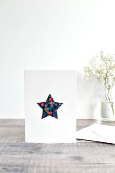 A lovely handmade fabric star sewn card made using pretty Liberty fabric stitched directly onto the card using freehand machine embroidery. A special Christmas card to send at Christmas time. Made by Stitch Galore. #sewncard #libertyfabriccard #libertyfabricstar #stitchedcard #starcard #stitchgalore Christmas Time, Christmas Cards, Freehand Machine Embroidery, Fabric Stars, Star Stitch, Liberty Fabric, Card Envelopes, Vintage Fabrics, Blank Cards