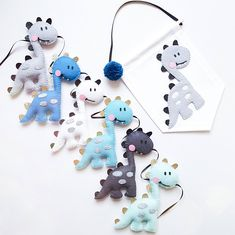 This is a super cute Dinosaur garland which would look lovely hung up in your childs nursery or bedroom, or it would make the perfect gift. This garland can be made in custom colours, please message me if you have any questions! Please choose from the drop down menu if you would