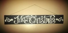 Merry Christmas sign painted on barn board.  John drew the font/stencil, and I painted and sanded it.