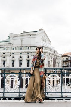Sara Escudero in a patterned cardigan, beige maxi dress and wedges all from Ralph Lauren