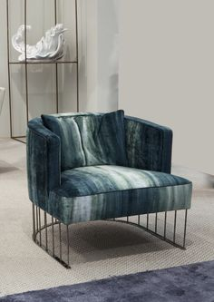 Upholstered fabric easy chair TENTAZIONE by ERBA ITALIA