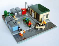 Super cute little station! Love the different heights sidewalk and the overflowing bin! Recycling station by LegoJalex, via Flickr