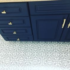 Finished my floor! And also painted our vanity cabinet navy blue and added new brass hardware! The mini Reno in the bathroom is coming along!! Augusta Tile Stencil 8 inch from Cutting Edge Stencils. http://www.cuttingedgestencils.com/augusta-tile-stencil-design-patchwork-tiles-stencils.html Project via @amydawndrysdale