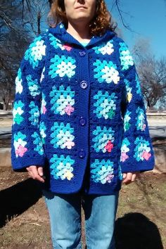 Womens and Teens Granny Style Coat w/Hood Hand crocheted in multi-color squares in a random order, in a Mitered Corner pattern. The base color is Royal Blue, with a Medium Blue, and Light Blue, then one of many different colors. Acrylic yarn. This coat has an attached hood . Made with love and