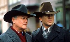 Larry Hagman and Patrick Duffy as JR and Bobby on Dallas  Love the hats!!!!