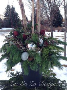 Fresh greenery, shiny balls - very inviting...Christmas planter