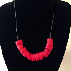 Edgy modern necklace. Red chunky polymer clay beads. Leather cord. Bold design
