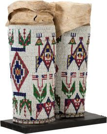 American Indian Art:Beadwork and Quillwork, A PAIR OF SIOUX WOMAN'S PICTORIAL BEADED HIDE LEGGINGS . c. 1890...(Total: 2 Items)