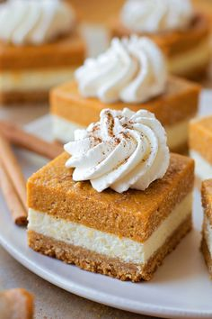 Pumpkin Cheesecake Bars - layers of goodness with a graham cracker crust, cheesecake layer and pumpkin layer. This will be perfect for all fall festivities!