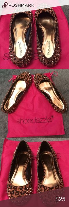 💥SALE💥 Leopard Print Gold Spike Flats 🐆 Worn once, in great shape, no signs of wear. Shoedazzle leopard print flats with lil gold spikes on the toes & heels. Good quality material & nice sturdy flats that will last a long time. Size 7.5 & comes with a nice pink Shoedazzle shoe bag. Super cute & edgy lil Flats. ******Free gift with purchase 😘 ShoeDazzle Shoes Flats & Loafers