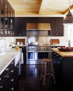 Robert Stillin, black kitchen with butcher block countertops | Remodelista