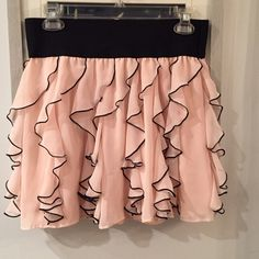 Express light pink and black frilly skirt Express light pink and black frilly skirt. With elastic band. Express Skirts Mini