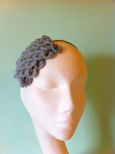 Knitted feather hairband by Tickledpinksheep on Etsy, £12.00