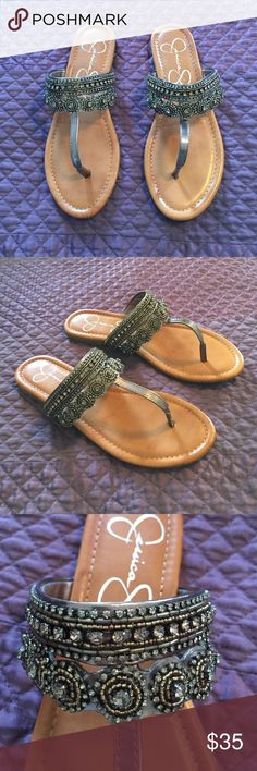 Jessica Simpson flat beaded sandals Jessica Simpson flat beaded sandals. Dark gray color. Worn once!!! They just don't fit me well. Super cute!!!! Will consider all offers!! Jessica Simpson Shoes Sandals