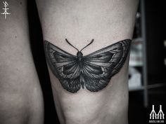 Above the knee black & grey Moth tattoo by Neal Panda
