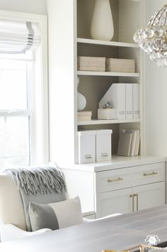 Built-ins bookshelf styling inspiration for home office. Walls Republic grass cloth and white paper storage. Amerock sea grass golden champagne hardware