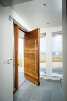 Floor also perhaps for entrance hall / ground floor loo Coastal Entry by The Bazeley Partnership Timber Sliding Doors, Wood Entry Doors, Front Door Entrance, House Front Door, House Doors, House Entrance, Main Entrance, Room Door Design, Door Design Interior