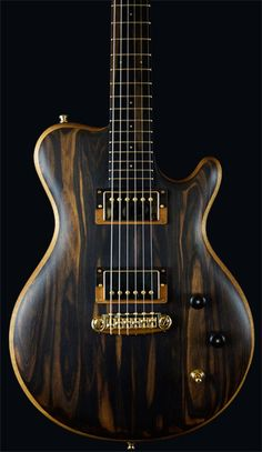 Alexander James Guitars - Custom guitar luthier specializing in custom guitars and instrument repair.