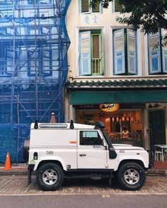 This clean Landy taking a rest after tackling the wild terrain for Singapore. #4WD #landroverdefender #dirtytruck #snorkel #parkingticket #blue #scaffolding by daniel__kong This clean Landy taking a rest after tackling the wild terrain for Singapore. #4WD #landroverdefender #dirtytruck #snorkel #parkingticket #blue #scaffolding