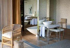 """""""When considering creating an open-plan bedroom and bathroom, it's important to decide which activities you are happy to share,"""" says Durban architect Joy Brasler, who designed this serenely stylish guest suite on the KwaZulu-Natal coast Open Plan Bathrooms, Classic Bathroom, Guest Suite, Open Concept, Master Bedroom, New Homes, Kwazulu Natal, Ocean, Joy"""