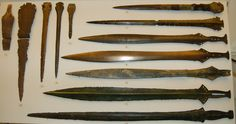 Shows swords crafted from early to late bronze age.  Bronze swords and armor are characteristic of the era