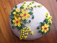 Quilling | Rock paper weights and doorstops decorated with Quilling