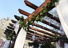 Flowing curtain panels on a Garden Wedding Pergola!  LINK:  http://www.kayleewebsterdesigns.com/sweet-vintage-garden-wedding/