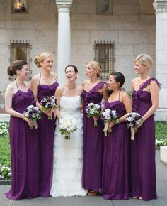 Long, purple bridesmaid dresses // Photo: Ned Jackson Photography // TheKnot.com
