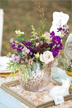 Vintage wedding centerpiece idea: purple and blush florals in a mecury vase.